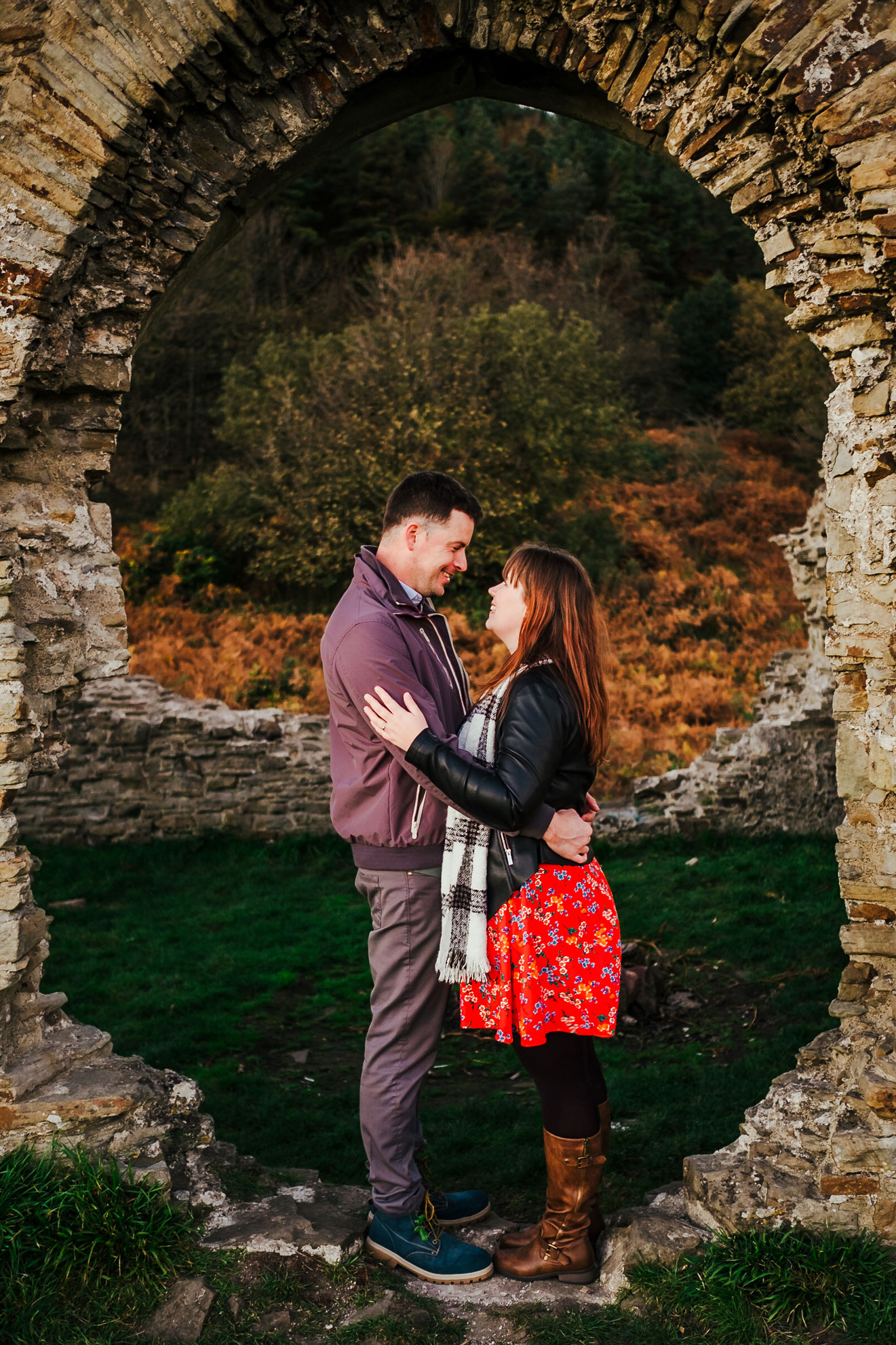 a couple kiss at the old monastery ruins at Margam park