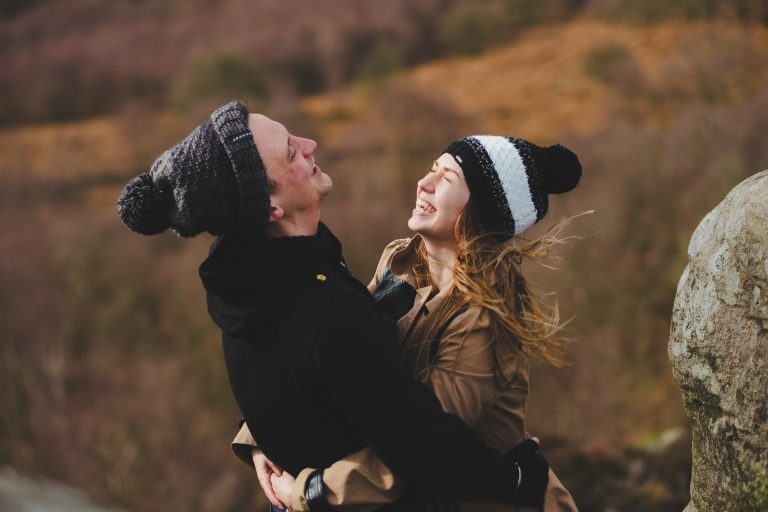 a couple laugh on their dartmoor engagement shoot