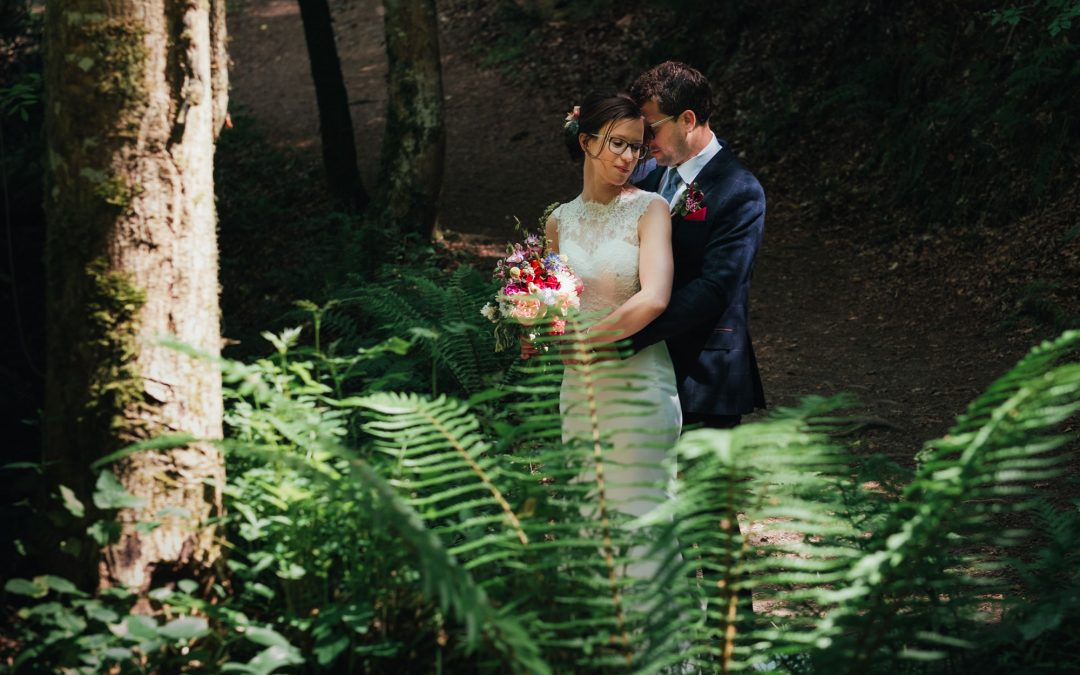 newly married couple in the woods at their festival wedding