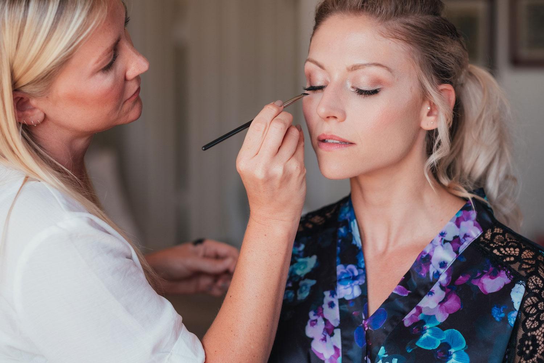 beautiful Bristol bride has her bridal make-up applied