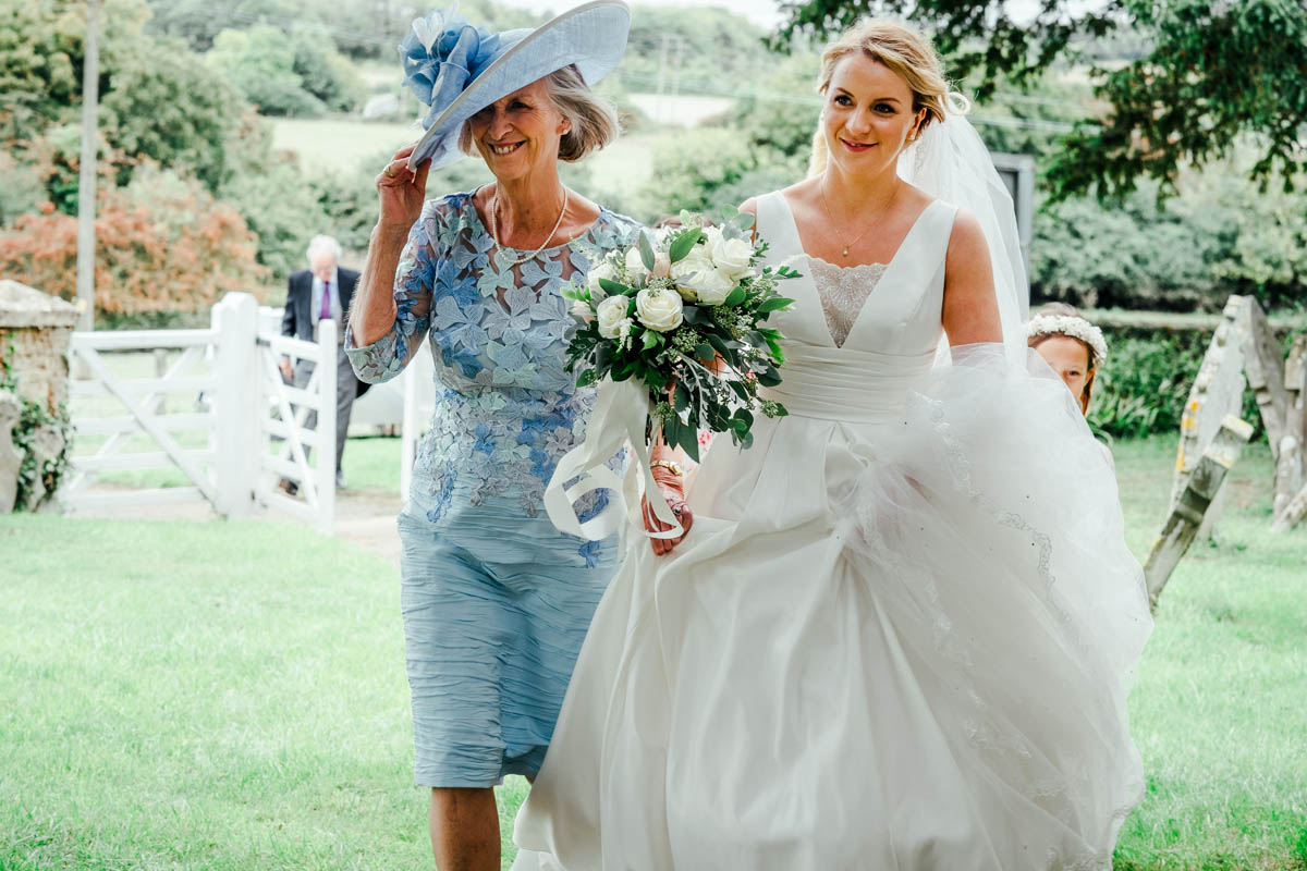 a bride being given away by her mum