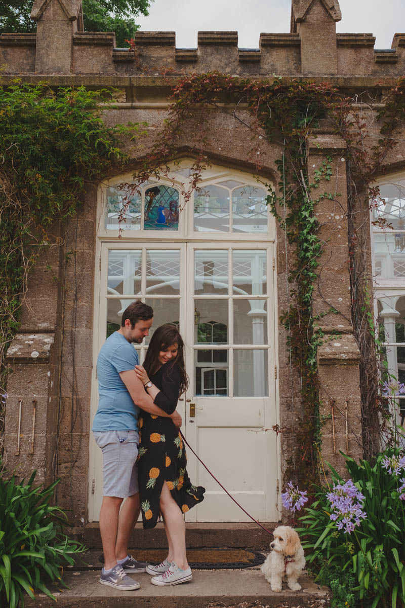 a couple in the doorway of the orangery at st audries park on their pre-wedding shoot