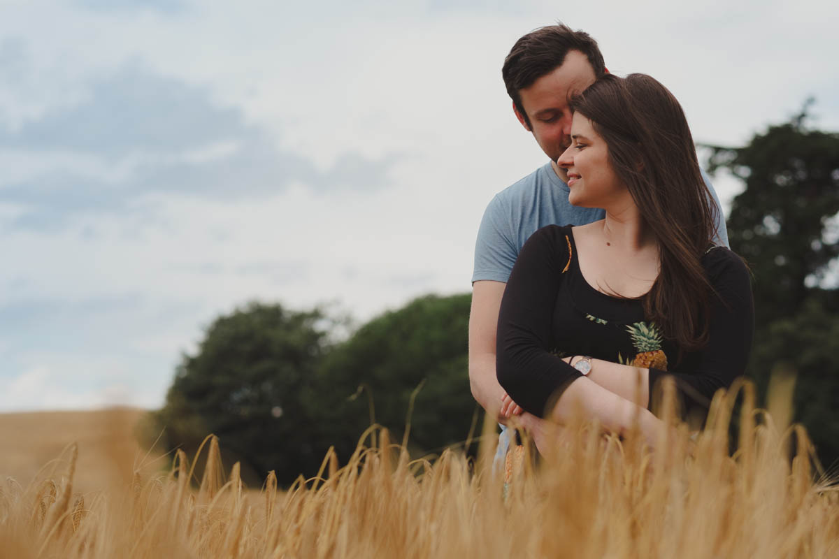 a couple kiss in a Somerset cornfield