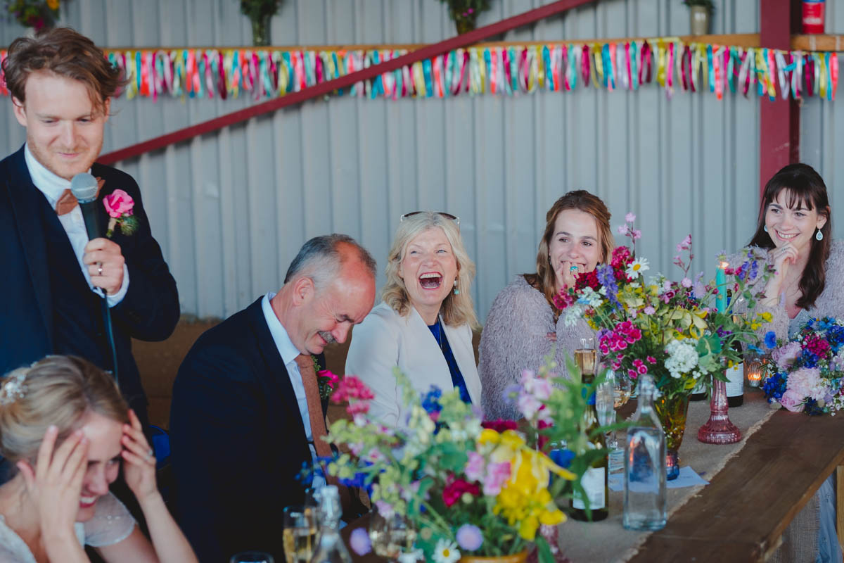mother-of-the-groom laughs at her son's speech