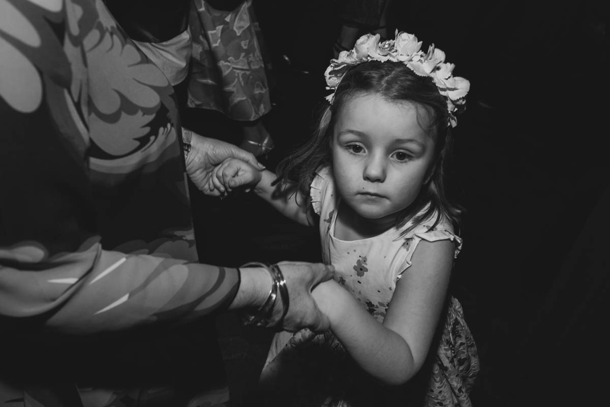 a little girl dances at the wedding reception