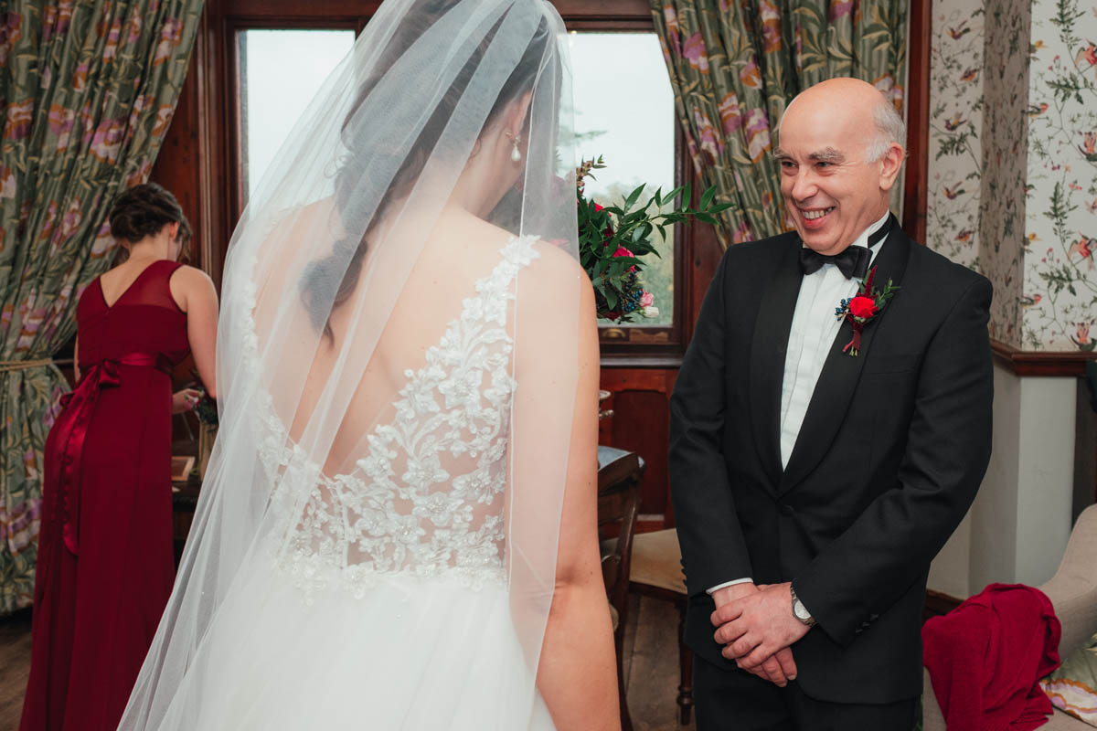 bride's father smiles as he see's her for the first time