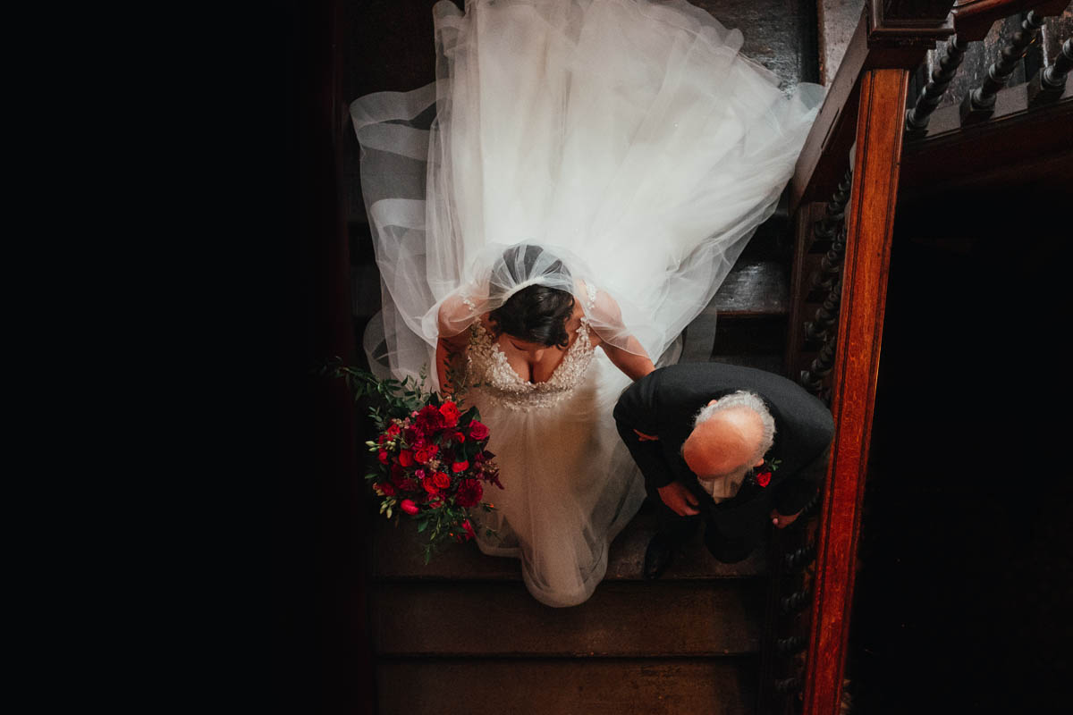 bride and her father descend the staircase