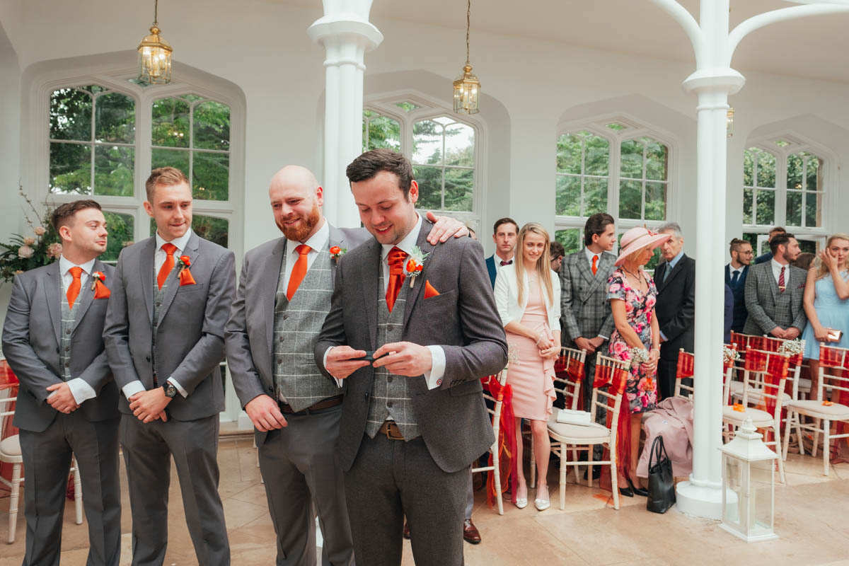 groom reaches for his tissue