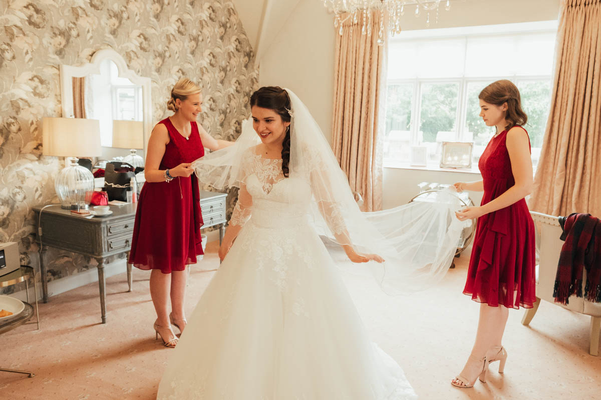 bride see's herself in her wedding dress for the first time