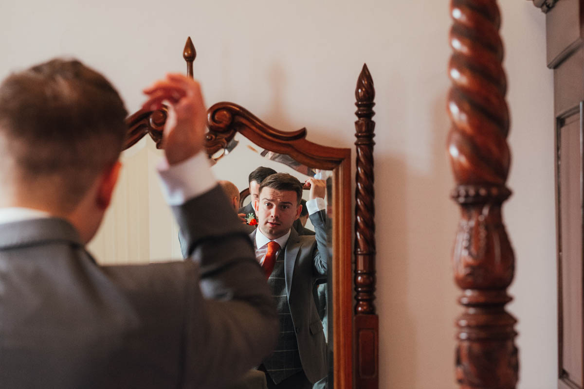 groomsman gets ready for the wedding