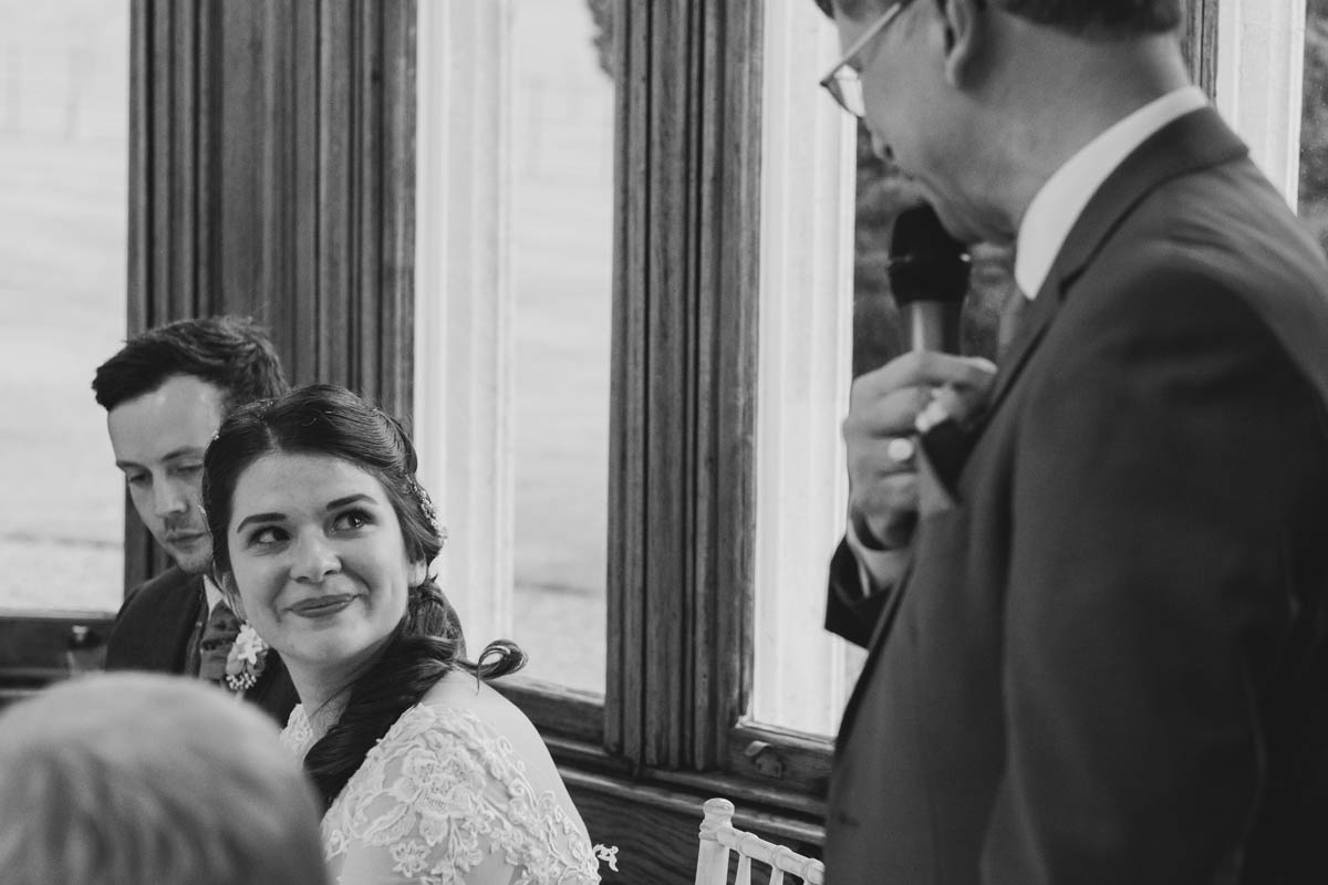 bride sheds a tear at her father's speech