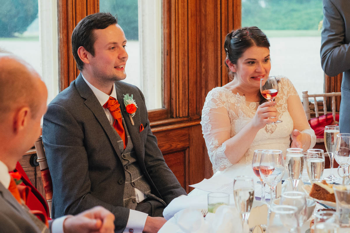 bride looks worried about her dad's speech