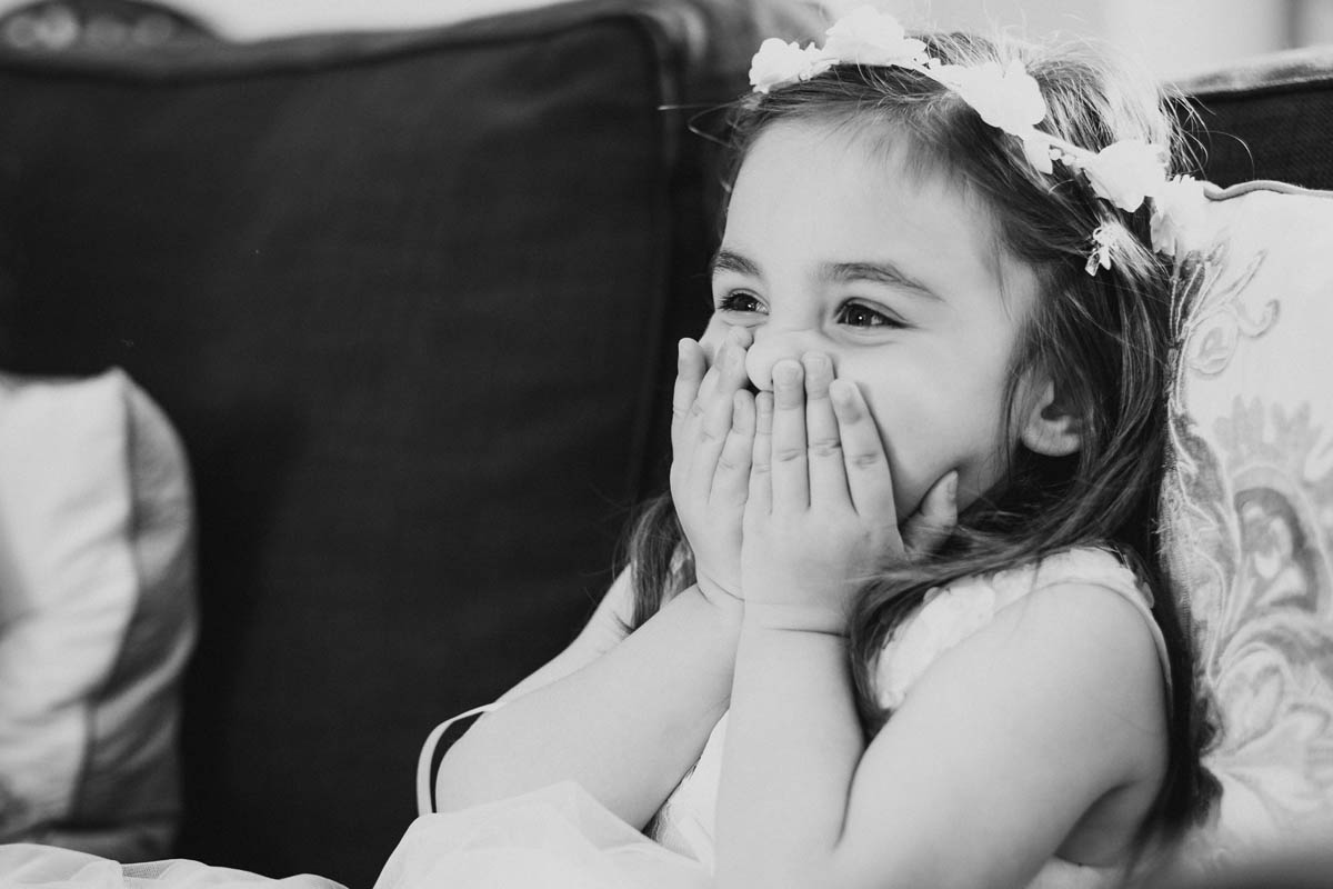a little girl shows delight at the sight of a bride
