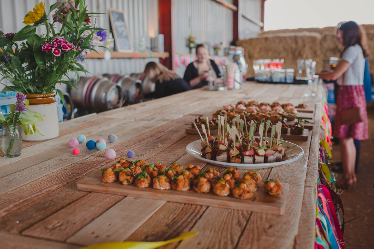 canapés sit on the bar at the Wiltshire farm wedding reception