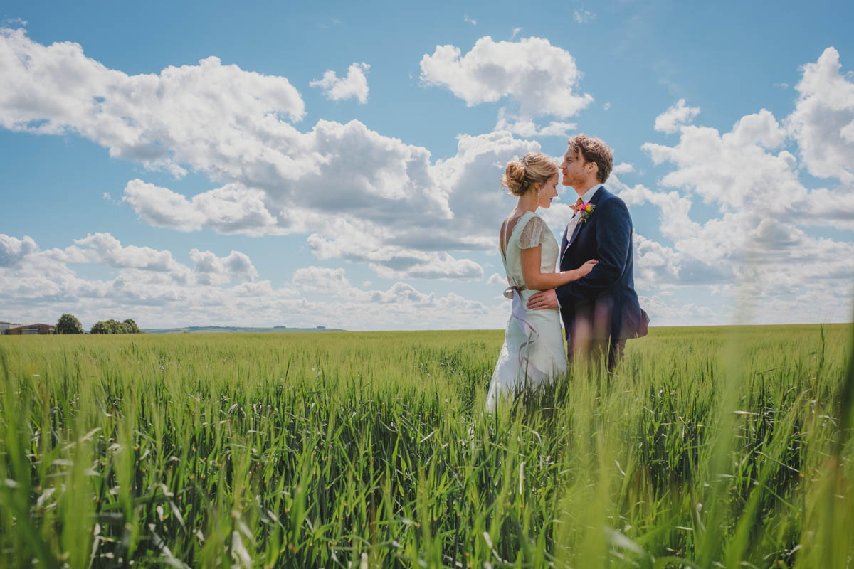 a newly wed couple on their Wiltshire farm at their wedding