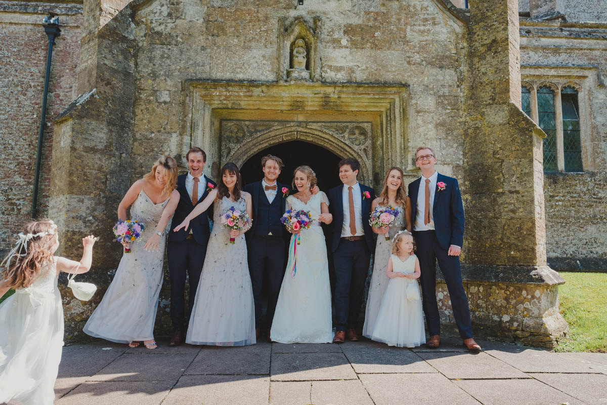 the bridal party at a church in Wiltshire