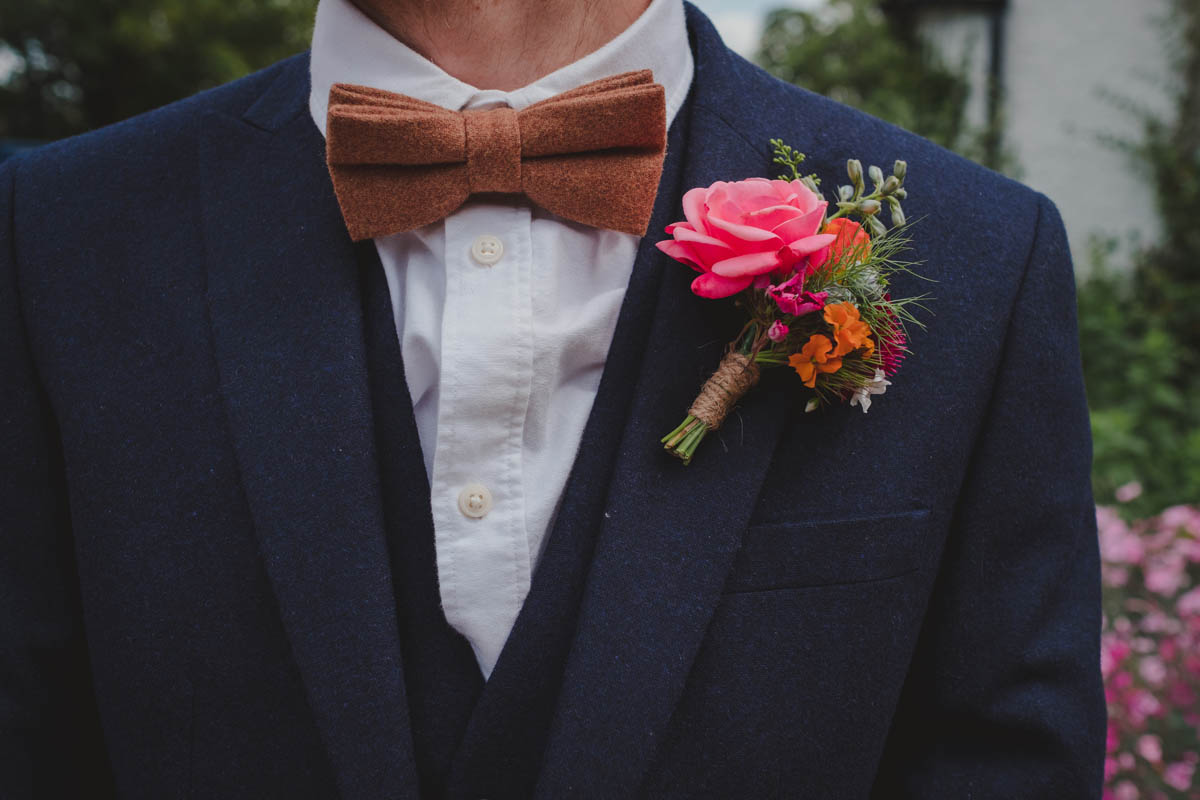 a close-up of a groom's buttonhole at a Wiltshire farm wedding