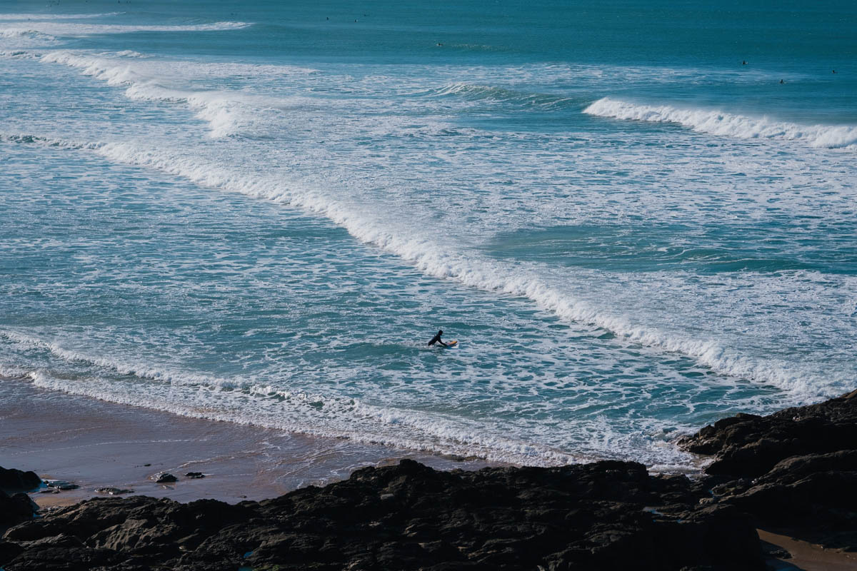 a surfer at fistral beach