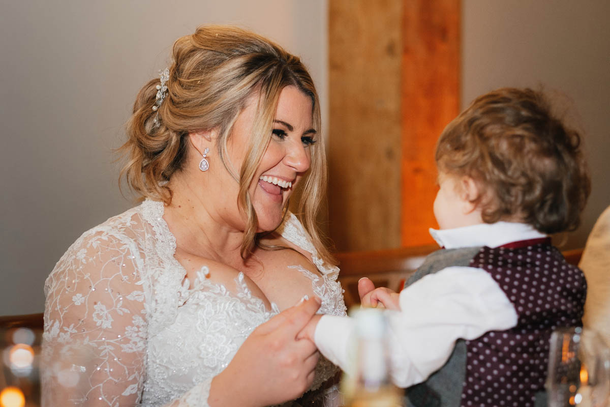 the bride plays with her baby nephew