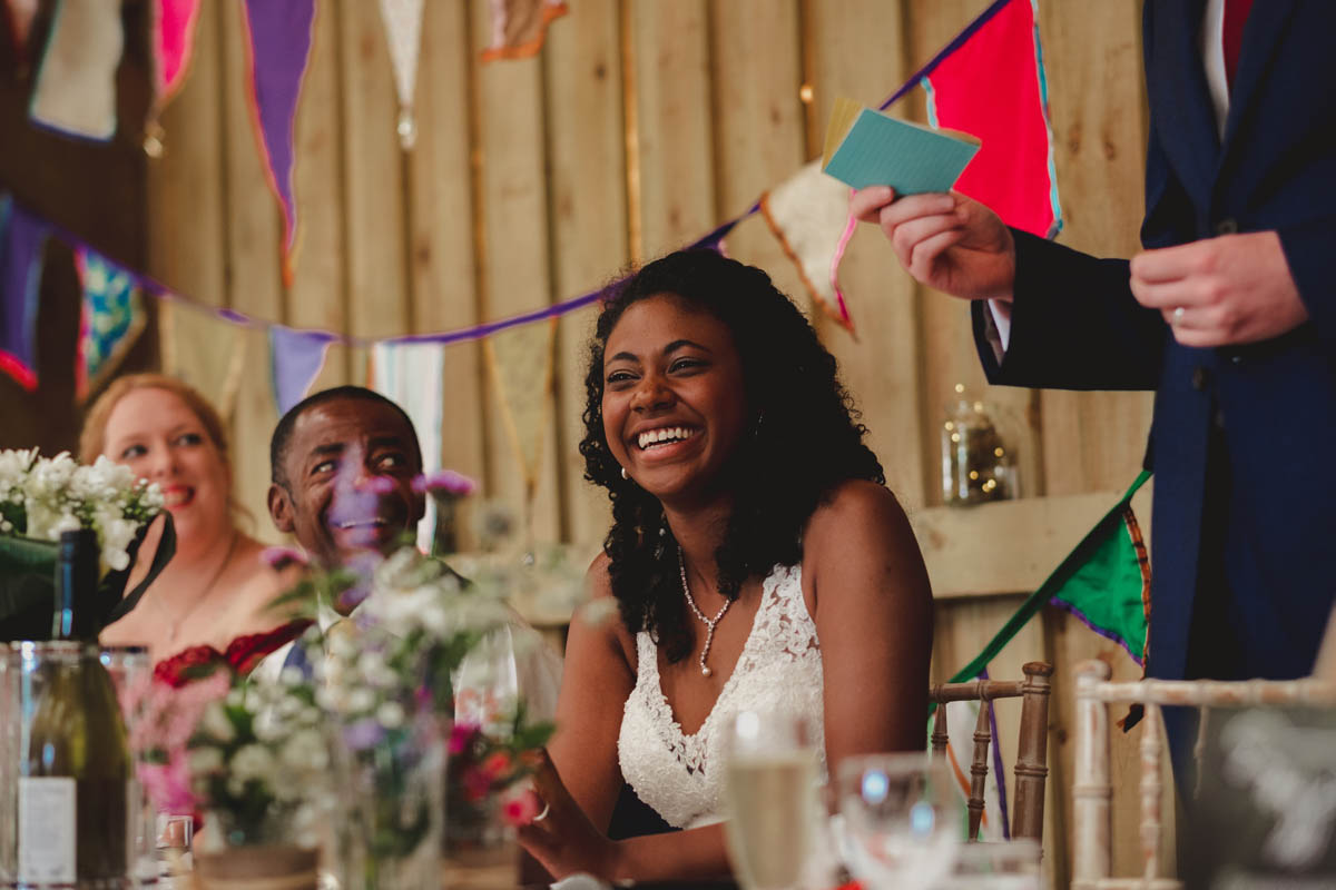 bride laughing at the grooms speech