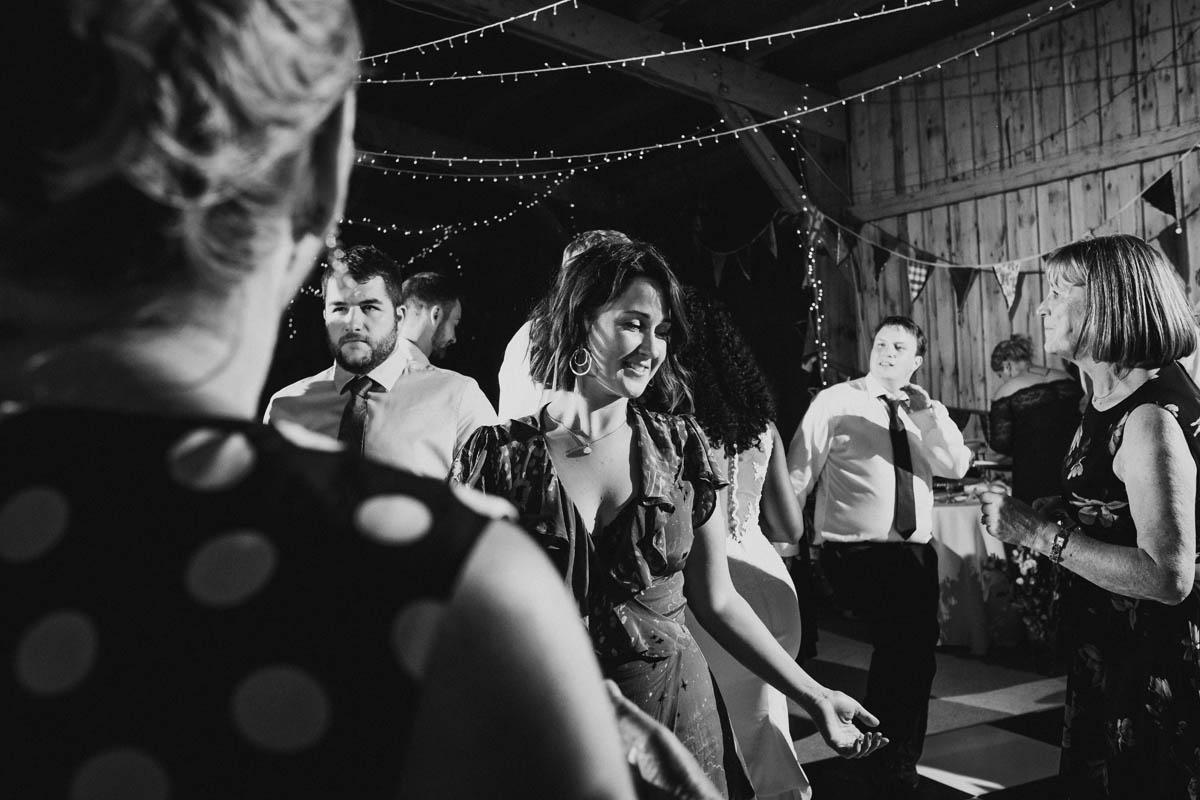 guests having fun dancing to a band at their dartmoor wedding