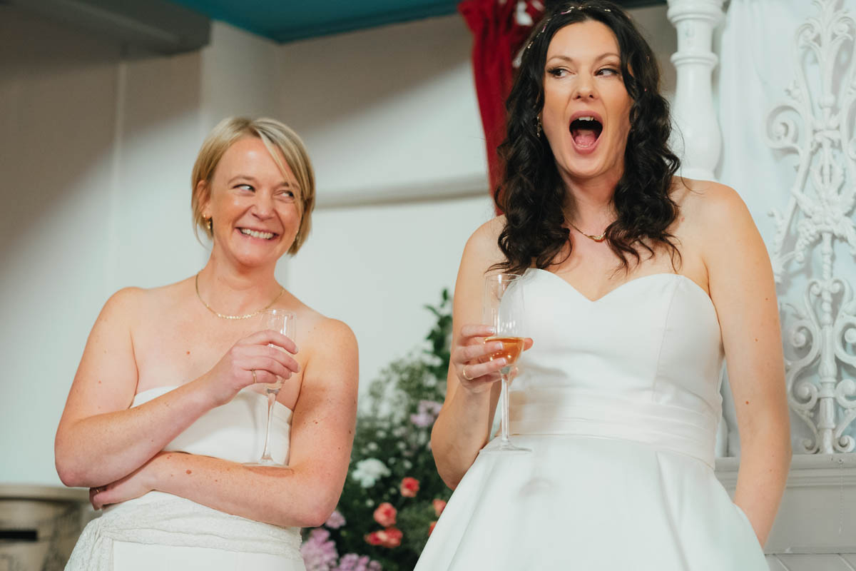 brides making funny faces at the speech