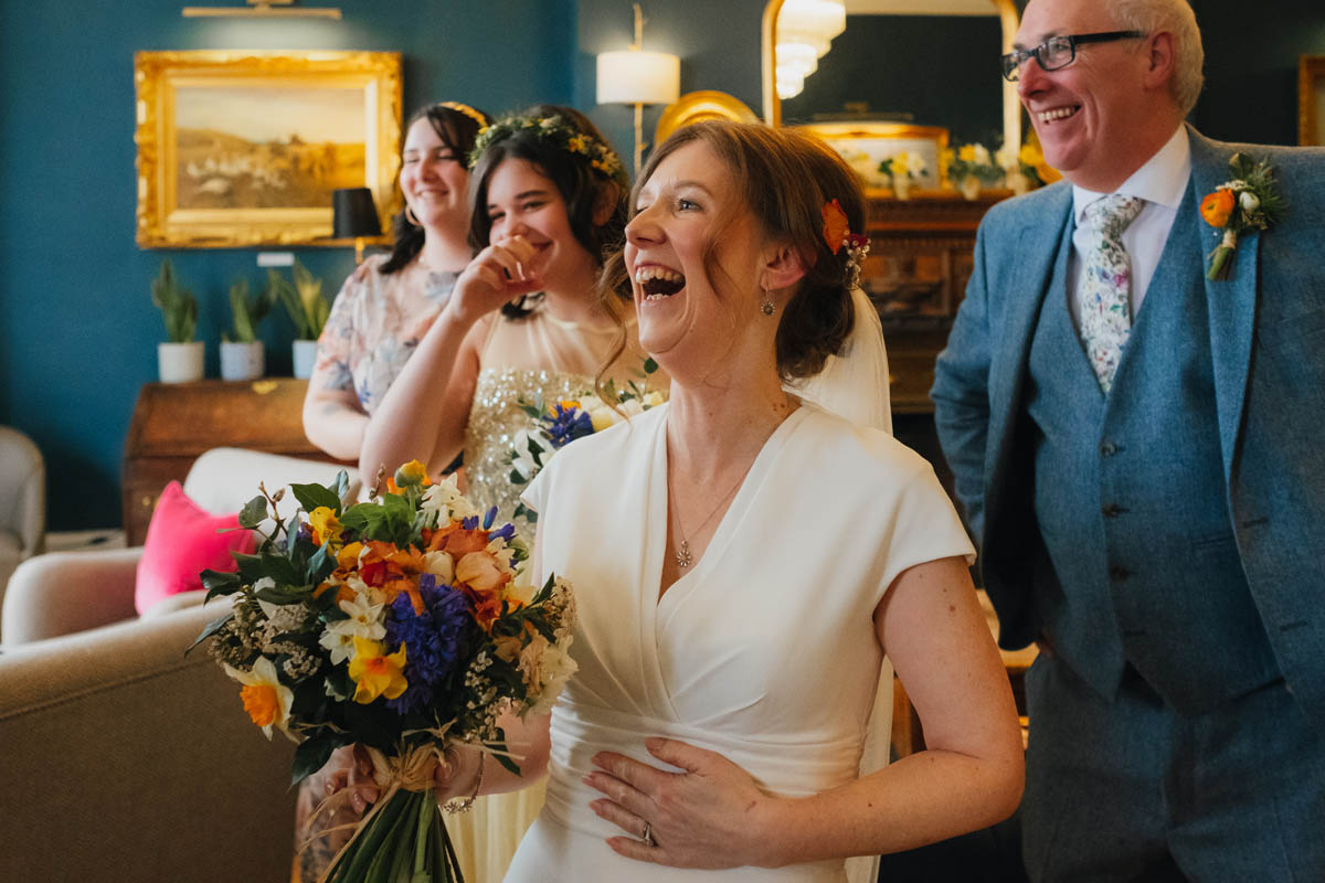 bride and her family laughing