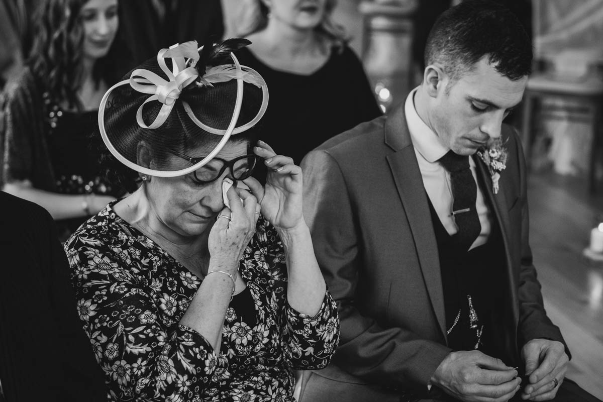mother of the groom cries