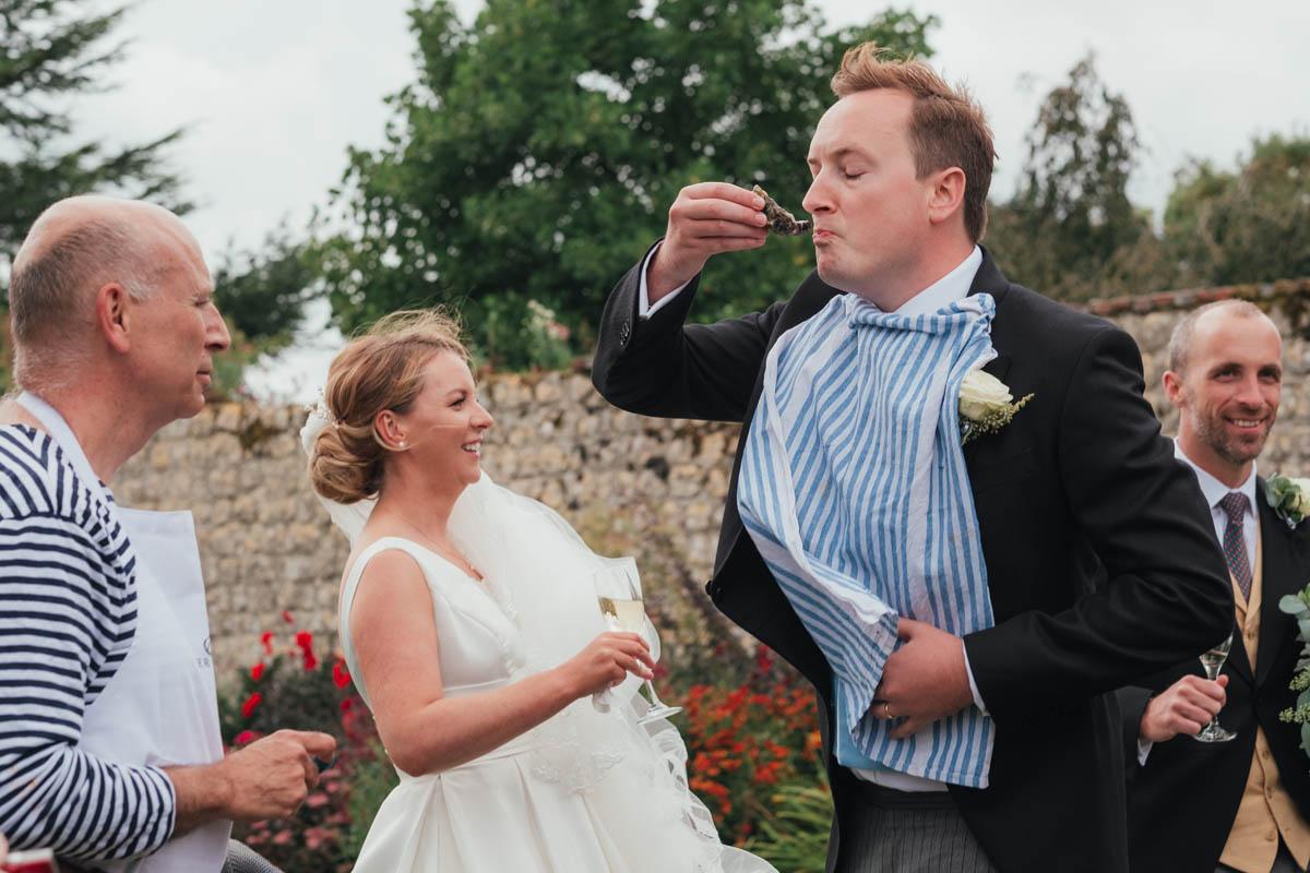 groom eats oysters