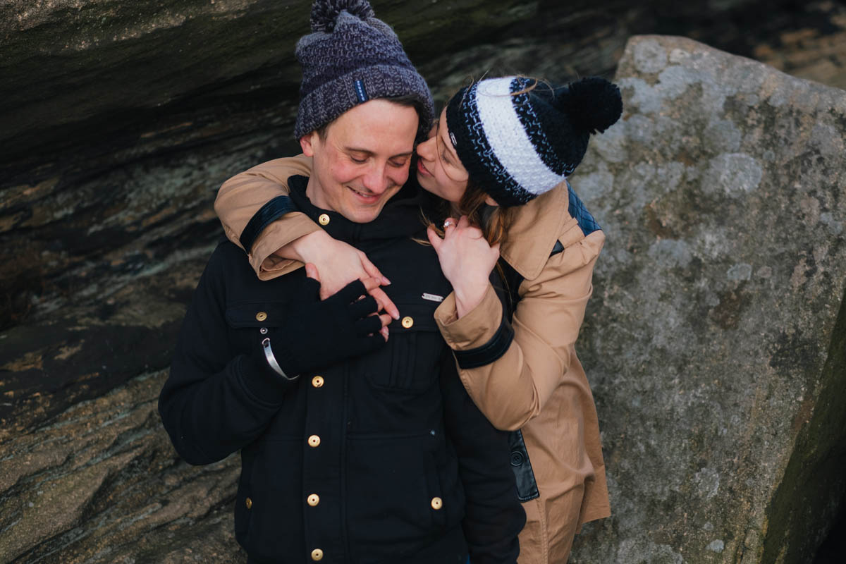 couple embrace on their engagement shoot
