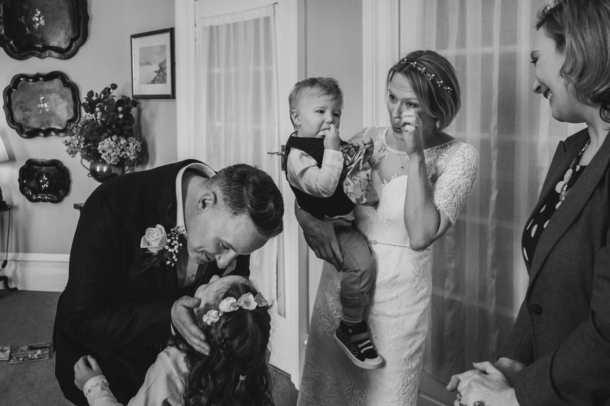 a newly wed couple share a moment with their children at their Bristol wedding ceremony